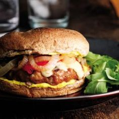 Spanish Pork Burgers  This Spanish-themed burger is boldly flavored with sautéed onions (which keep it moist), paprika, garlic and green olives. The creamy mayonnaise spread is tangy with lemon and a hint of earthy saffron.