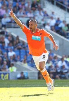 Kevin Phillips of Blackpool celebrates after scoring the equalising goal against Brighton & Hove Albion during the npower Championship match between Brighton & Hove Albion and Blackpool at Amex Stadium on August 2011 in Brighton, England. Football Kits, Football Soccer, Brighton & Hove Albion, Brighton England, Blackpool Fc, British Football, Premier League, Basketball Court, The Incredibles