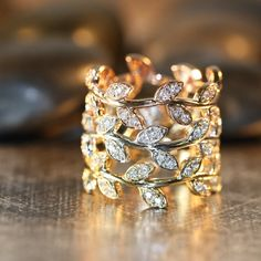 This intricate and gorgeous leaf ring is handcrafted in solid 14k gold (your choice of white, yellow or rose gold) studded with sparkling conflict