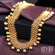 Enhance your festive look with this gold long necklace. Having intricate design this set is sure to match with all your traditional attires. Gold Temple Jewellery, Real Gold Jewelry, Gold Wedding Jewelry, Solid Gold Jewelry, Golden Jewelry, Gold Jewellery Design, Bridal Jewelry Sets, Bridal Jewellery, Indian Jewelry Sets