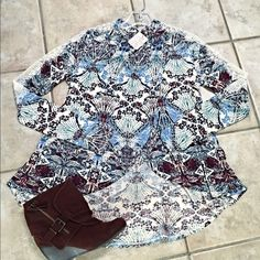 NWT Free People lace detail Blouse stunning! Tulip cut front with high neckline- lace detail in stems pretty blue and plum- hi lo with top back cut out! Free People Tops Blouses