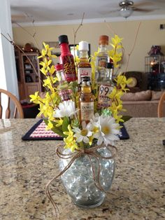 Liquor bouquet I made my cousin Alcohol Gift Baskets, Liquor Gift Baskets, Alcohol Gifts, Raffle Baskets, Liquor Bouquet, Gift Bouquet, Candy Bouquet, Mini Alcohol Bouquet, Auction Baskets