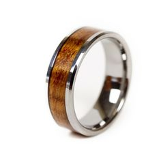 Koa Eternity Ring.  Made with our own private stock of Koa wood from the Big Island and Tungsten, the hardest metal in the world.  Guaranteed never to scratch or dull.  Perfect for a lifetime commitment.  Comes in a solid Koa box, engraved with our logo.