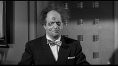 Larry Fine has lipstick marks on his face, from his sweetie, and two black eyes from Moe. | Gypped in the Penthouse (1955), a Three Stooges short produced and directed by Jules White; distributed by Columbia Pictures