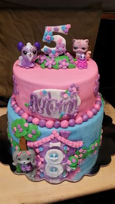 Littlest Pet Shop - Littlest Pet Shop theme. WASC with Vanilla BC.  Decorations are fondant except the plastic pet shop animals. Definitely used some wonderful CC designs...so thank you very much.