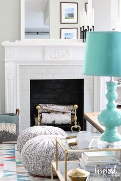 Give your room an easy facelift by painting your fireplace. Check out this before and after from Michael of Inspired By Charm.