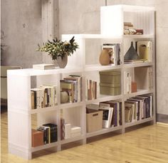 Modular Stair Step Bookcase Room Divider For Dining Area.