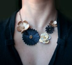 Leather flower statement necklace. So cute!