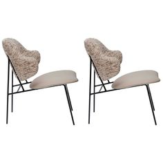 Pair of Ib Kofod-Larsen Leather and Silk Shell Lounge Chairs | From a unique collection of antique and modern lounge chairs at https://www.1stdibs.com/furniture/seating/lounge-chairs/