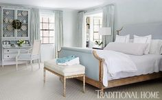 This master bedroom gracefully wears light blue from head to toe. - Traditional Home ®/ Photo: Werner Straube / Design: Stephanie McKean for Nora C. Marra Interiors