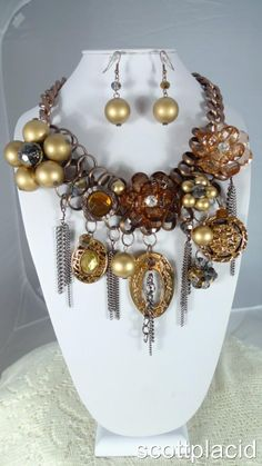 "CHUNKY ELEGANT GOLDEN BROWN ACRYLIC AND PEARL BURNISHED COPPER TONE METAL BIB NECKLACE SET     * If you need a necklace extender I have them for sale in my store.*          NECKLACE: 20"" L + 2"" EXTENTION    CHARM: 5"" LONG    HOOK EARRINGS: 2"" L           COLOR: BROWN & BURNISHED COPPPER TONE  $34.99"