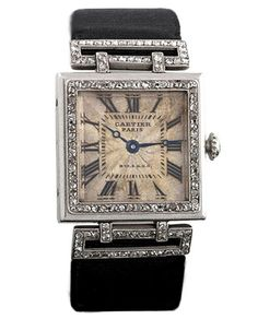 ♔ A Cartier Art Deco platinum and 18k gold watch with diamonds ~ 1920