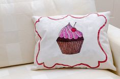 Hand painted pillow of a colorful cupcake with by ThePillowWorld