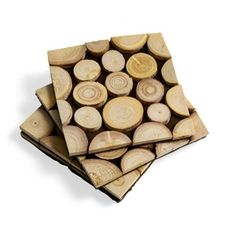 Teak Coasters made from 70 % Teak wood/ 30% EVA foam. Assembled by slicing cross sections of tree branches that would otherwise be burned, then sizing the individual slices to form a kind of natural parquet pattern. www.hatchecolifestyle.com