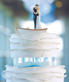 Wedding Cake Topper from Wedding Stars Unique Collection Feature Bride and Groom in a Row Boat. Available with Hair Color Choices