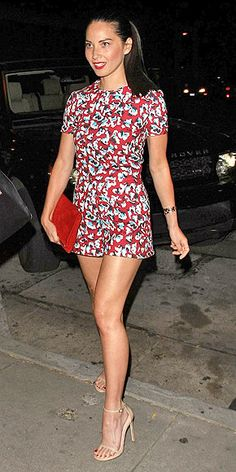 Love Her Outfit! Star Style to Steal | OLIVIA MUNN | We're not necessarily saying you're going to want to spend $1,880 on a playsuit, as the actress did with this Mary Katrantzou number. What we are saying is that the look can be surprisingly sophisticated when you have the perfect fit, sexy accessories (nude Stuart Weitzman heels and a Kurt Geiger London clutch, in this case) and a matte red lip.