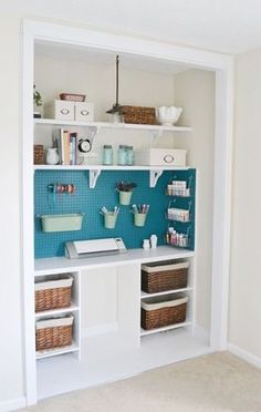 Craft Closet... hang curtains over doorway to conceal.