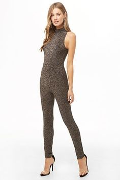 A rainbow metallic knit jumpsuit featuring a mock neck, sleeveless cut, skinny leg, and a cutout back with button-loop closures. Jumpsuit Dressy, Halter Jumpsuit, Sweater Shop, Ugly Sweater, Spandex Catsuit, Metallic Jumpsuits, One Shoulder Jumpsuit, Modern Vintage Fashion, Holiday Dresses