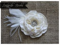 BRIDAL FLOWER HAIR Pin with Feathers /// Ivory - Bridal Fascinator - Bridal Hair Accessory - Bridal Hair Clip - Wedding Hair Accessory. $23.95, via Etsy.