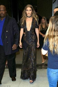 Taking the plunge: Gigi risked a major wardrobe malfunction as she attended…