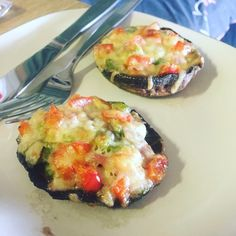 Grilled mushroom topped with capsicum, spring onion, garlic, cheese and bacon