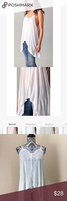 Cheap Monday white mindy asymmetrical button tank Great condition! No flaws. The mindy tank by cheap Monday. Asymmetrical cut with faux buttons down the front. Great basic tank to wear with anything super cute and crisp white color. Cheap Monday Tops Tank Tops
