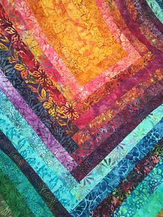 Jelly roll big log cabin Quilt uses Catalina Batiks by Moda