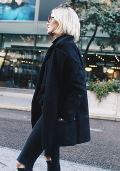 Josefin Dahlberg rocks all black in this shearling coat and ripped jeans.Jacket: Second Female, Polo: Bik Bok, Jeans: Diesel, Boots: DinSko.