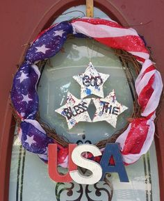 USA, RED WHITE BLUE wreath..used a flag scarf from target ,(wrapped it on a grapevine wreath) USA letters from target, painted stars  with God Bless America
