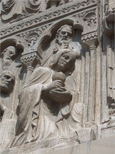 This tympanum hangs over Cathedral of the Madeleine in Salt Lake. It was created by Francis Aretz of Pittsburgh, Penn. Shipped in pieces to Utah in 1917, the tympanum features Christ as High Priest, flanked by angels; and the Twelve Apostles, six standing and six kneeling. Saints Jerome, Ambrose, Gregory and Augustine, appear in the upper half of the work. Saints Matthew, Mark, Luke and John surround the arms of the central cross. Photo by Donna M. Brown, Copyright © 2010…