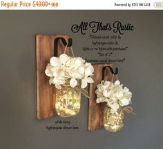 New and Improved Listing :)! This listing is for a Set of 2 stunning Hanging Mason Jar Sconces. These sconces are hand crafted with the best quality. These make such wonderful rustic accents to any home decor! They are so versatile!! You will adore them for years to come :) These also make a unique and rustic gift for a housewarming or for any occasion! You can use them for several uses!! Black hooks are made in house by us! They are our own design and are made with quality and durability…