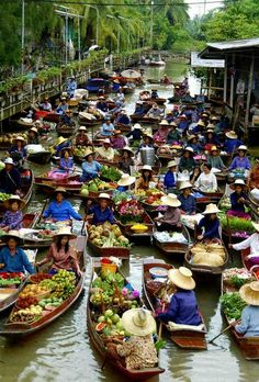 Floating Market, Bangkok, Thailand. Discover the greatest markets in Thailand; they are not your typical markets you would expect to find. More info; http://theculturetrip.com/asia/thailand/