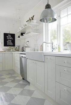 Gorgeous Swedish kitchen with white cabinets, open shelving, farmhouse sink (IKEA?), industrial style pendant, and gray checkerboard painted wood floors. Swedish Kitchen, Swedish Cottage, New Kitchen, Kitchen White, Kitchen Wood, Country Kitchen, Kitchen Interior, Vintage Kitchen, Stainless Kitchen