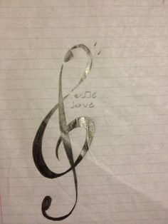 """Treble/bass clef tattoo. """"One love"""" spelled out in mostly music notes."""