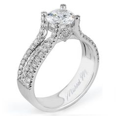 A bridge of pave set diamonds is bordered by two strings of u-set diamonds, adding unique visual details to an engagement ring style.Diamond info: 0.65 (centerstone not included)