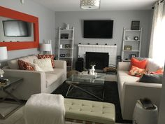 Grey and orange living room. Paint by Behr, Silver Bullet in semi-gloss...