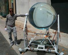 This is a sun tracking, solar energy concentrator. It can collect light from both the sun and the moon and convert it into electricity. According to the designer, it can concentrate both sunlight and moonlight x10,000.     For more info:http://bit.ly/OD9EpF