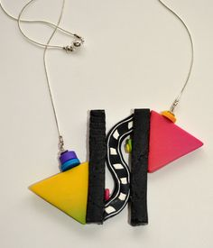 Offset triangle necklace on silver plated chain.