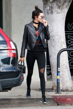 Black workout tights, rock / graphic tee, sneakers / chucks, black leather jacket, choker, sunglasses, black bag