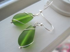 Hey, I found this really awesome Etsy listing at http://www.etsy.com/listing/151401433/green-sea-glass-earrings-olivine