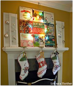 fun and funky! vintage album covers as mantle art, and an old holiday rug repurposed as christmas stockings.