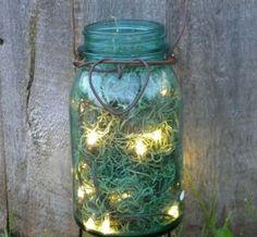 "spanish moss in mason jars with ""firefly"" lights"