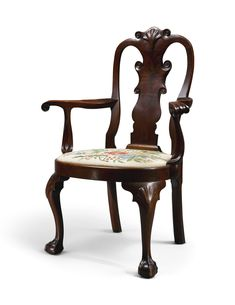 Exceptional Queen Anne Carved and Figured Walnut Compass-Seat Open Armchair, Philadelphia, circa 1760 -  retains a dark rich historic surface,  Height 42 3/4 in.