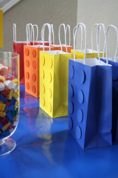 DIY lego bag for boys birthday party. Use a solid color bag and cut out circles from craft foam and then glue it on the bag to make it look like an actual lego brick! Lego Bag, Lego Gifts, Diy Gifts, Wrap Gifts, Handmade Gifts, Boy Birthday, Birthday Parties, Birthday Ideas, Lego Parties