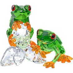 Honoring the unique flora and fauna of the rainforest, this pair of Swarovski frogs sparkles in a combination of vibrant crystal colors. The frogs... Shop now