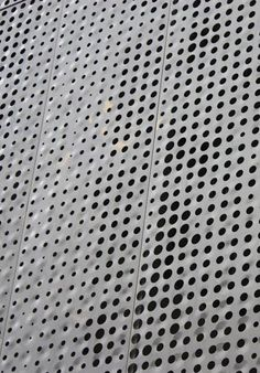 DETAIL OF PERFORATED METAL PANELS AT THE FAIRMONT HOTEL. COURTESY ZAHNER