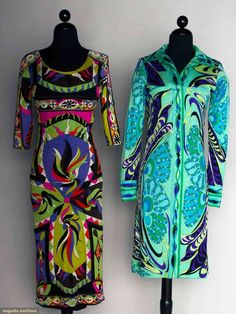 """Two Pucci Printed Day Dresses, 1970s, Augusta Auctions, November 13, 2013 - NYC, Lot 201 Both silk jersey knit, label """"Emilio Pucci Florence Italy"""": 1 shirt-style sheath, long cuffed sleeves, print in shades of blue, green, & pur"""