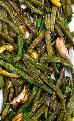 These roasted green beans with lemon and garlic are super-easy to make, down right delicious, full of flavor, and have only four ingredients. Now that's winning at life! | sodamndelish.com