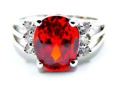 Oval 1 Carat Red Garnet with 1/2 Carat Round Simulated White Diamond Side Stone Accents Anniversary Ring, Size 6 Ziva, LLC. $29.99. Get 15% off your order when you order 2 or more items sold by Ziva, LLC (20% for 4 or more)-use claim code SHOPZIVA at checkout. Product photos are of the actual item you'll be receiving; no computer generated imagery is used. Save 61% Off!