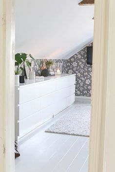 scandi bedroom The stunning Waldemar wallpaper by Boråstapeter in light grey. Attic Master Bedroom, Scandi Bedroom, Bedroom Wardrobe, Attic Rooms, Home Bedroom, Low Ceiling Bedroom, Ikea Malm, Big Girl Rooms, Cottage Living